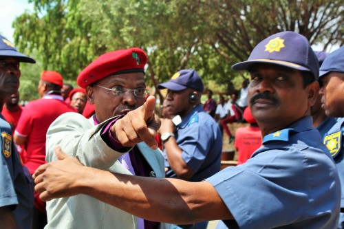 Members of the Free State Economic Freedom Fighters and police in a heated argument after the party disrupted the State of the Province Address.