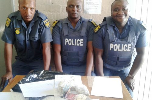 Constable Tumelo Mokoena, Bonisile Fubu and Sergeant Kabelo Moholo with the recovered mandrax/Photo Supplied