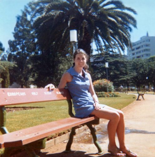 Cathy Sinclair Dolphin during one of her visits to South Africa. Here she is sitting on one of the well-known 'Europeans only' benches.