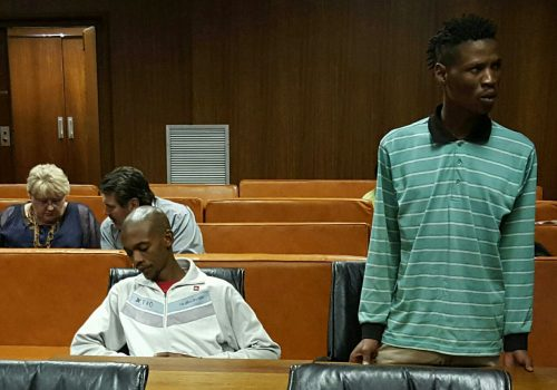 Tshepo Smith, sitting left, and Thato Lefutho, standing right, in the Free State High Court after sentencing. Photo: André Grobler